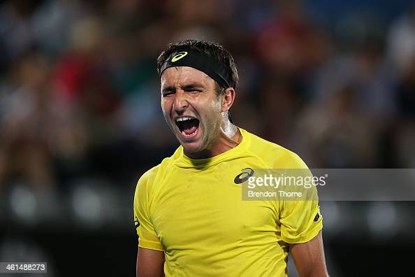 Marinko Matosevic of Australia shows his frustration in his quarter final match against Sergiy Stakhovsky of the Ukraine during day five of the 2014...