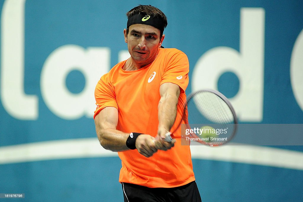 Marinko Matosevic of Australian plays a shot in his match against Milos Rasonic of Canada during the 2013 Thailand Open at Impact Arena on September 26, 2013 in Bangkok, Thailand.
