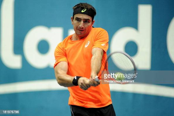 Marinko Matosevic of Australian plays a shot in his match against Milos Rasonic of Canada during the 2013 Thailand Open at Impact Arena on September...