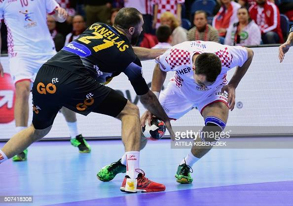 Marino Mari of Croatia fights for the ball with Joan Cañellas of Spain during the semifinal match of the Men's 2016 EHF European Handball...