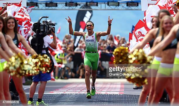 Marino Vanhoenacker of Belgium celebrates as he wins the mens race during Ironman Klagenfurt on June 28 2015 in Klagenfurt Austria
