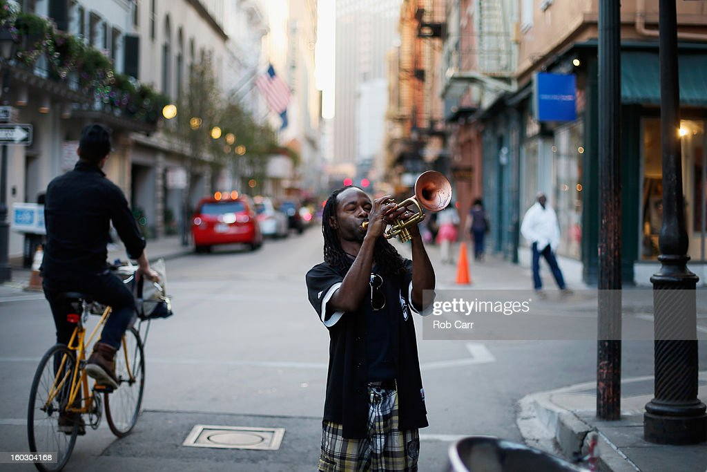 Mario Abney plays the trumpet on Bourbon Street in the French Quarter January 28 2013 in New Orleans Louisiana