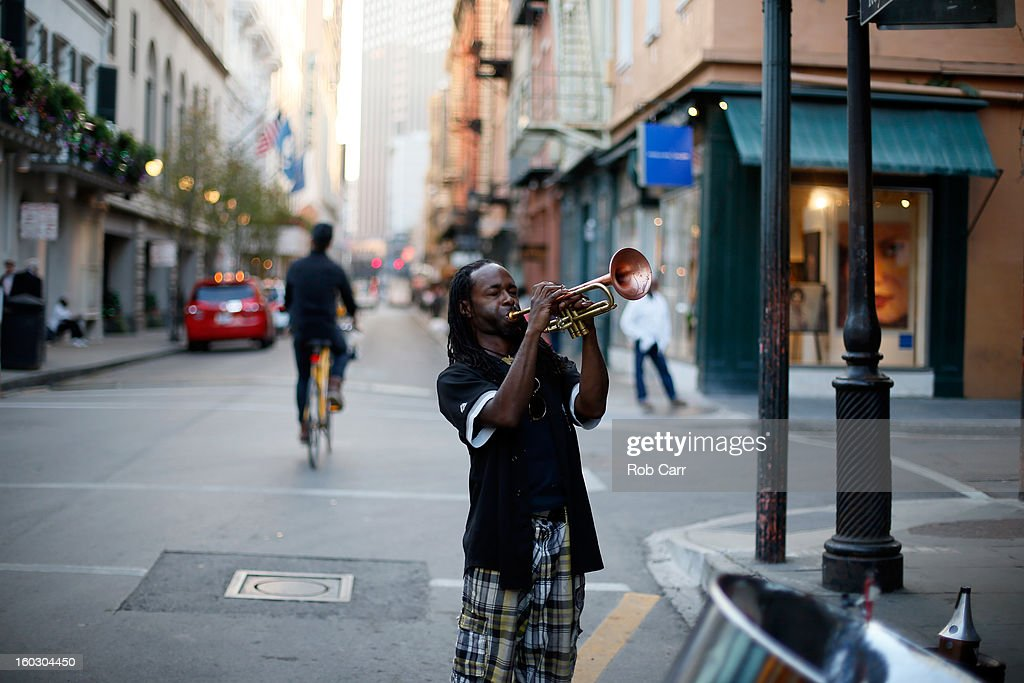 Mario Abney plays the trumpet on Bourbon Street in the French Quarter January 28, 2013 in New Orleans, Louisiana.