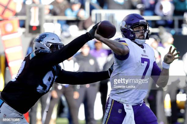 Mario Addison of the Carolina Panthers strips the ball from Case Keenum of the Minnesota Vikings in the third quarter during their game at Bank of...