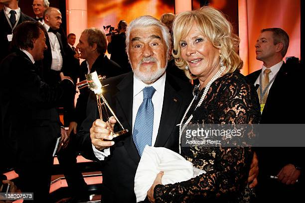 Mario Adorf and wife Monique pose with his Goldene Kamera Lifetime Achievement award during the 47th Golden Camera Awards at the Axel Springer Haus...