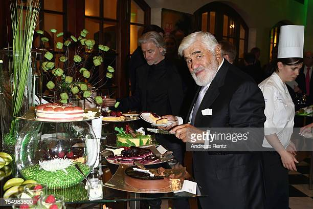 Mario Adorf chooses pieces from the dessert buffet during the 15th Busche Gala at Adlon Hotel on October 29 2012 in Berlin Germany