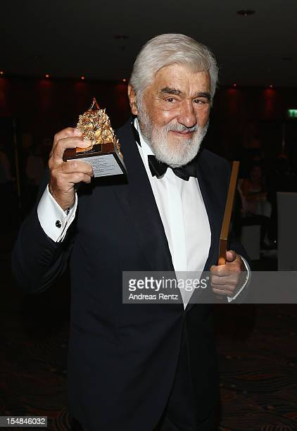 Mario Adorf holds up his award during the 21st UNESCO Charity Gala 2012 on October 27 2012 in Dusseldorf Germany