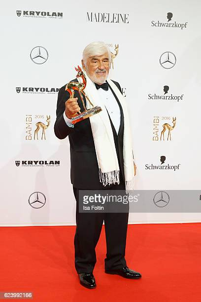 Mario Adorf poses with award at the Bambi Awards 2016 winners board at Stage Theater on November 17 2016 in Berlin Germany