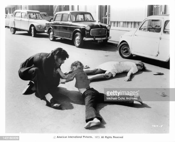 Mario Adorf screams in agony after the mob kills his wife Sylva Koscina and daughter in a car crash in a scene from the film 'The Italian Connection'...