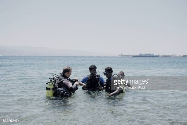 Mario Aiello diving instructor Richard Amegah immigrant from Ghana Boubacar Barry immigrant from Senegaland Giuseppe Pinci coordinator of the project...