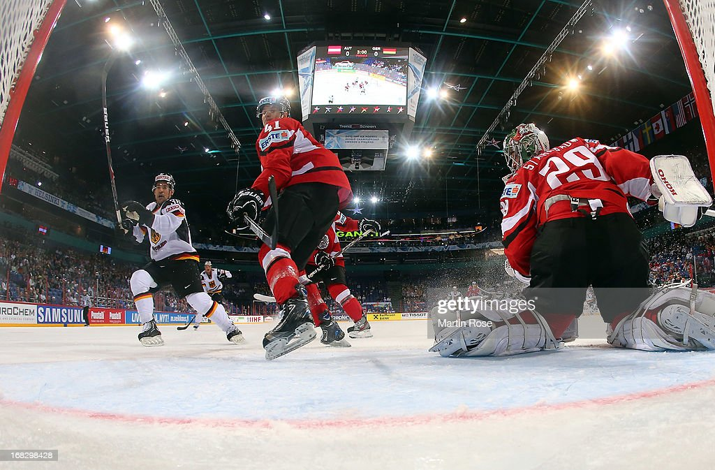 Mario Altmann (#41) of Austria stops th eshot of Yannic Seidenber (#36) of Germany during the IIHF World Championship group H match between Austria and Germany at Hartwall Areena on May 8, 2013 in Helsinki, Finland.