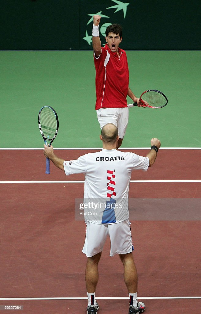 Mario Ancic celabrates with Ivan Ljubicic of Croatia after winning the doubles match against Michal Mertinak and Dominik Hrbaty of Slovakia during...