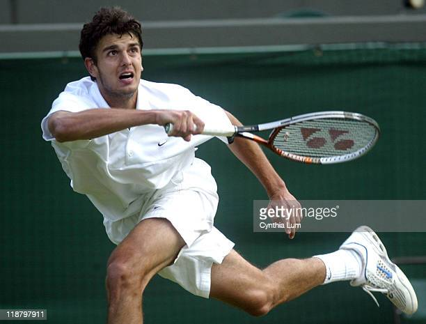 Mario Ancic down one set to Anydy Roddick before rain stops semifinal match at 64 43 July 2 2004