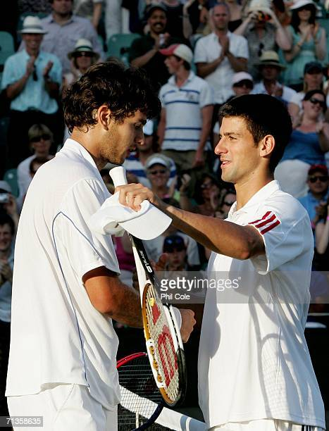 Mario Ancic of Croatia and Novak Djokovic of Serbia and Montenegro embrace after Mario Ancic won their match during day seven of the Wimbledon Lawn...