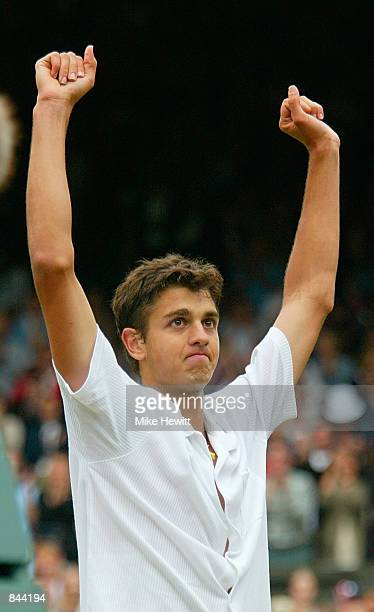Mario Ancic of Croatia celebrates after his victory against Roger Federer of Switzerland at the All England Tennis Championships at the All England...