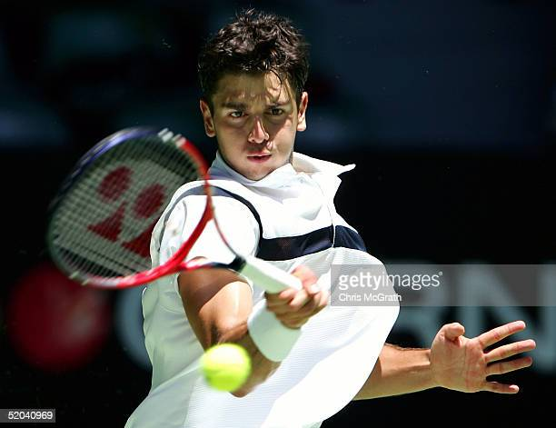 Mario Ancic of Croatia hits a forehand against Marat Safin of Russia during day five of the Australian Open Grand Slam at Melbourne Park January 21...