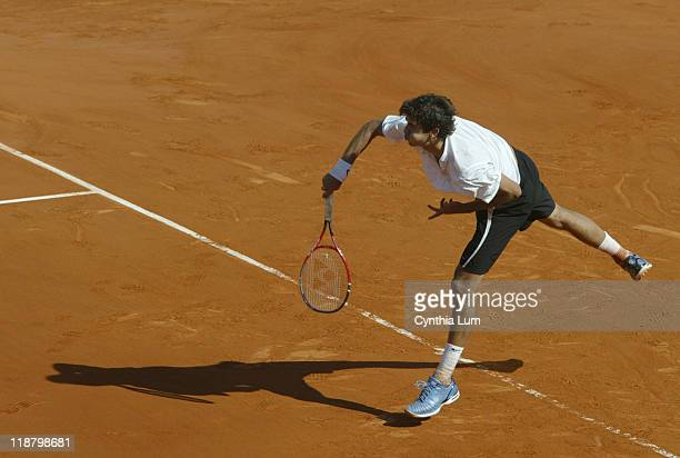 Mario Ancic of Croatia in action during his defeat by Switzerland's Roger Federer in the quarter final of the 2006 French Open at Roland Garros in...