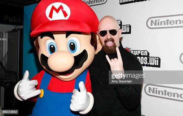 Mario and Judas Priest's Rob Halford attends the 25 years of Mario celebration at the Nintendo World Store on November 12 2009 in New York City