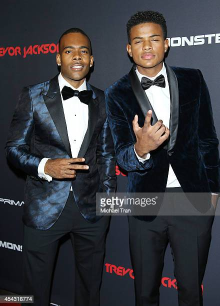 Mario and Trevor Jackson arrive at Trevor Jackson's Monster 18th birthday party held at El Rey Theatre on August 28 2014 in Los Angeles California