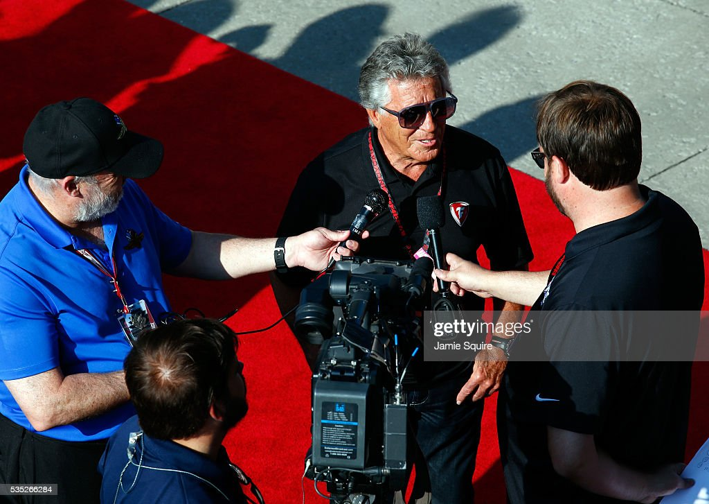 <a gi-track='captionPersonalityLinkClicked' href=/galleries/search?phrase=Mario+Andretti&family=editorial&specificpeople=93739 ng-click='$event.stopPropagation()'>Mario Andretti</a> is interviewed in the red carpet area prior to the 100th running of the Indianapolis 500 at Indianapolis Motorspeedway on May 29, 2016 in Indianapolis, Indiana.