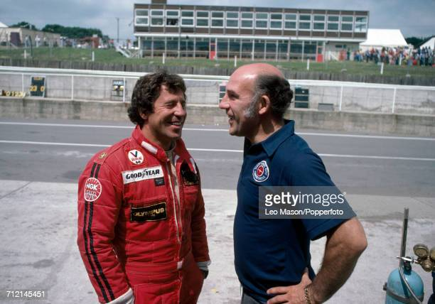 Mario Andretti of the United States and Stirling Moss of Great Britain pictured together at the British Grand Prix at Brands Hatch England on 16th...