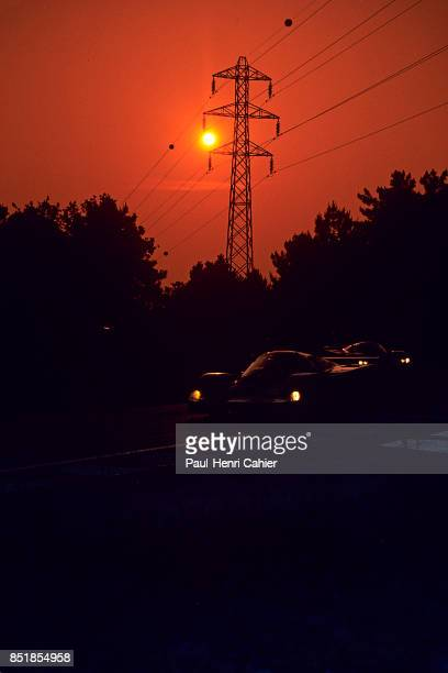 Mario Andretti Porsche 956 24 Hours of Le Mans Le Mans 19 June 1983 Mario Andretti drives his Porsche 956 into the sunset Le Mans 1983