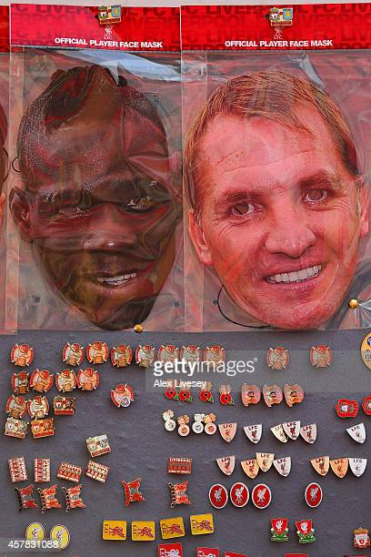 Mario Balotelli and Brendan Rodgers face masks are displayed for sale at a stall outside the stadium before the Barclays Premier League match between...