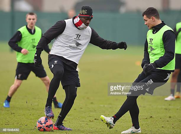 Mario Balotelli and Dejan Lovren of Liverpool in ation during a training session at Melwood Training ground on January 22 2015 in Liverpool England