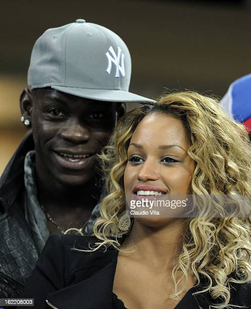 Mario Balotelli and Fanny Neguesha attend the UEFA Champions League Round of 16 first leg match between AC Milan and Barcelona at San Siro Stadium on...