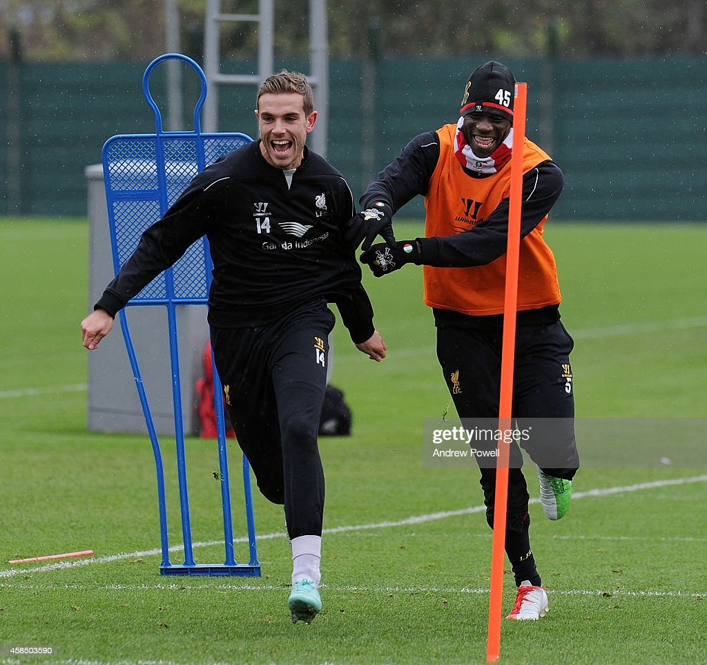 Mario Balotelli and Jordan Henderson of Liverpool laughing during a training session at Melwood Training Ground on November 6, 2014 in Liverpool, England.