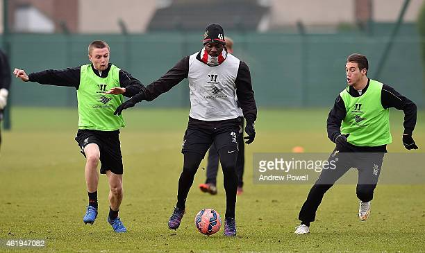 Mario Balotelli and Jordan Rossiter of Liverpool in ation during a training session at Melwood Training ground on January 22 2015 in Liverpool England