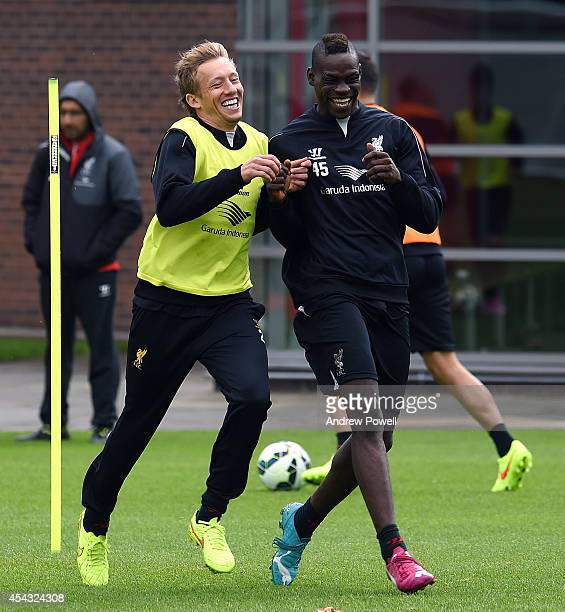 Mario Balotelli and Lucas Leiva of Liverpool in action during a training session at at Melwood Training Ground on August 29 2014 in Liverpool England