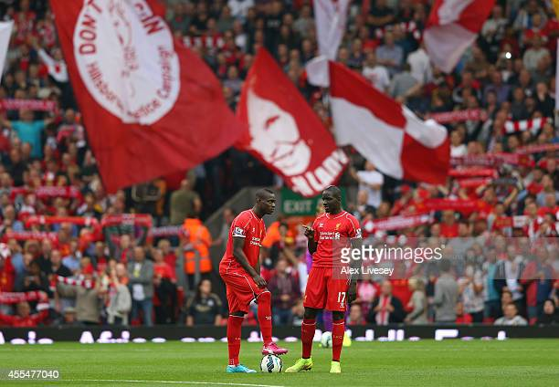 Mario Balotelli and Mamadou Sakho of Liverpool talk prior to kick off in the the Barclays Premier League match between Liverpool and Aston Villa at...