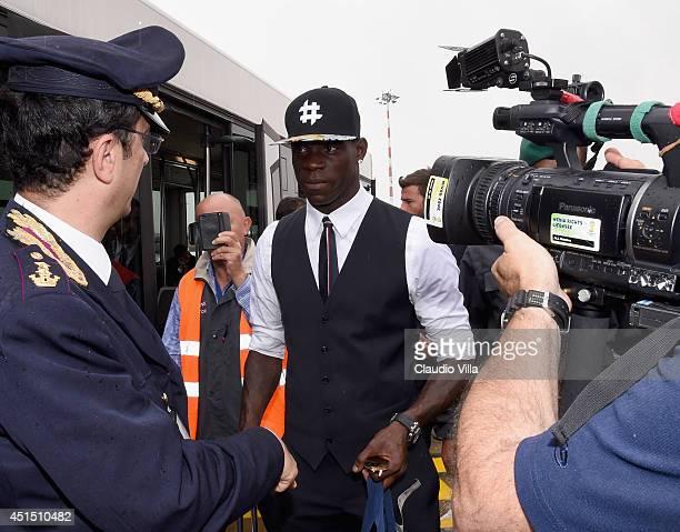 Mario Balotelli arrives at Malpensa Airport on June 26 2014 in Milan Italy