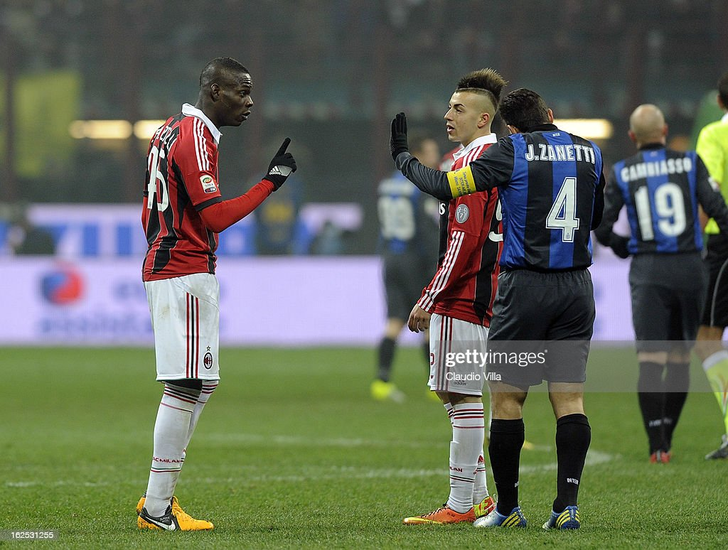 Mario Balotelli of AC Milan (L) and Javier Zanetti of FC Inter Milan speak during the Serie A match FC Internazionale Milano and AC Milan at San Siro Stadium on February 24, 2013 in Milan, Italy.