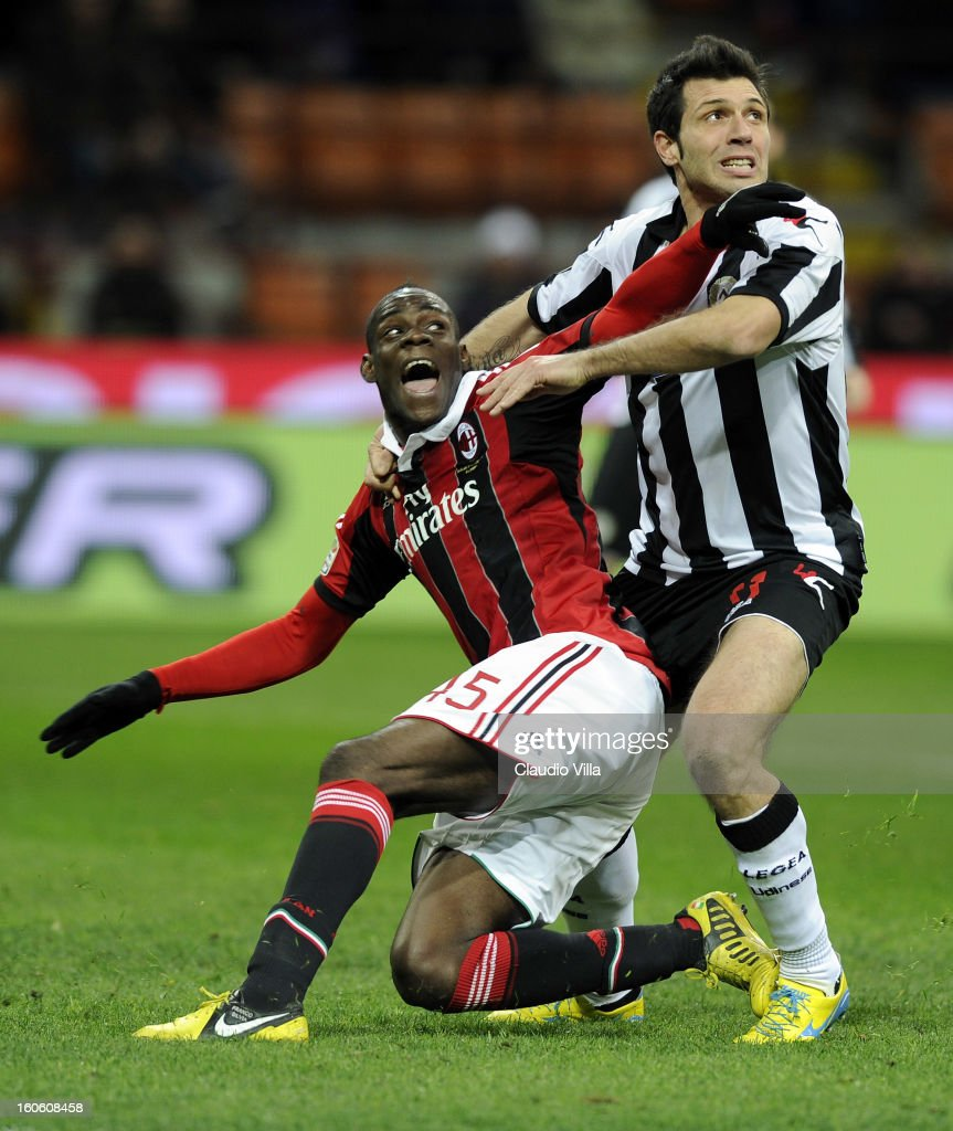 Mario Balotelli of AC Milan and Maurizio Domizzi of Udinese Calcio (R) compete during the Serie A match between AC Milan and Udinese Calcio at San Siro Stadium on February 3, 2013 in Milan, Italy.
