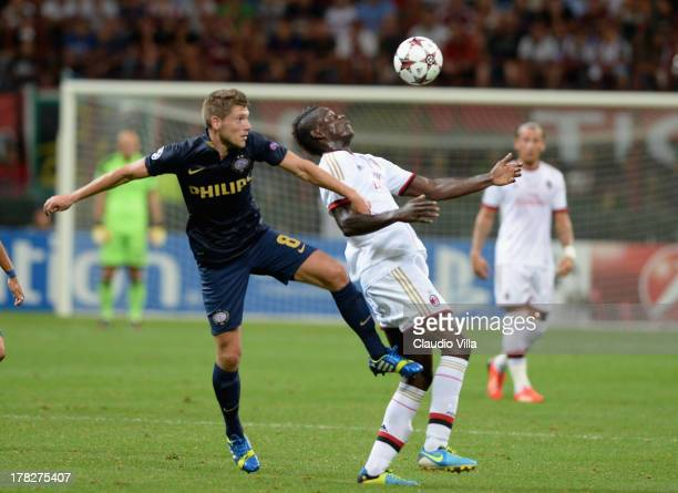 Mario Balotelli of AC Milan and Stijn Schaars of PSV compete for the ball during the UEFA Champions League Playoff Second Leg match between AC Milan...