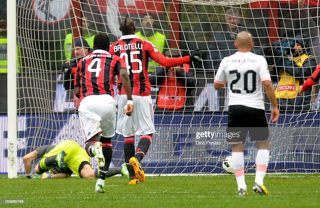 Mario Balotelli #45 of AC Milan celebrates after scoring a penalty during the Serie A match between AC Milan and US Citta di Palermo at San Siro Stadium on March 17, 2013 in Milan, Italy.