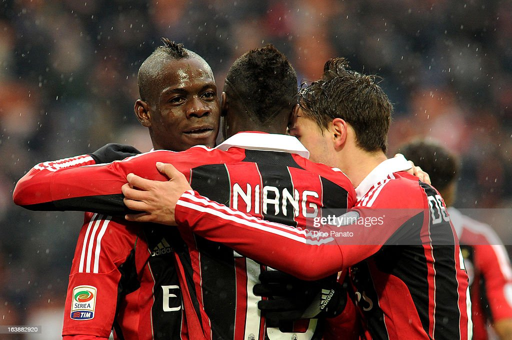 Mario Balotelli (L) of AC Milan celebrates after scoring his team's second goal during the Serie A match between AC Milan and US Citta di Palermo at San Siro Stadium on March 17, 2013 in Milan, Italy.