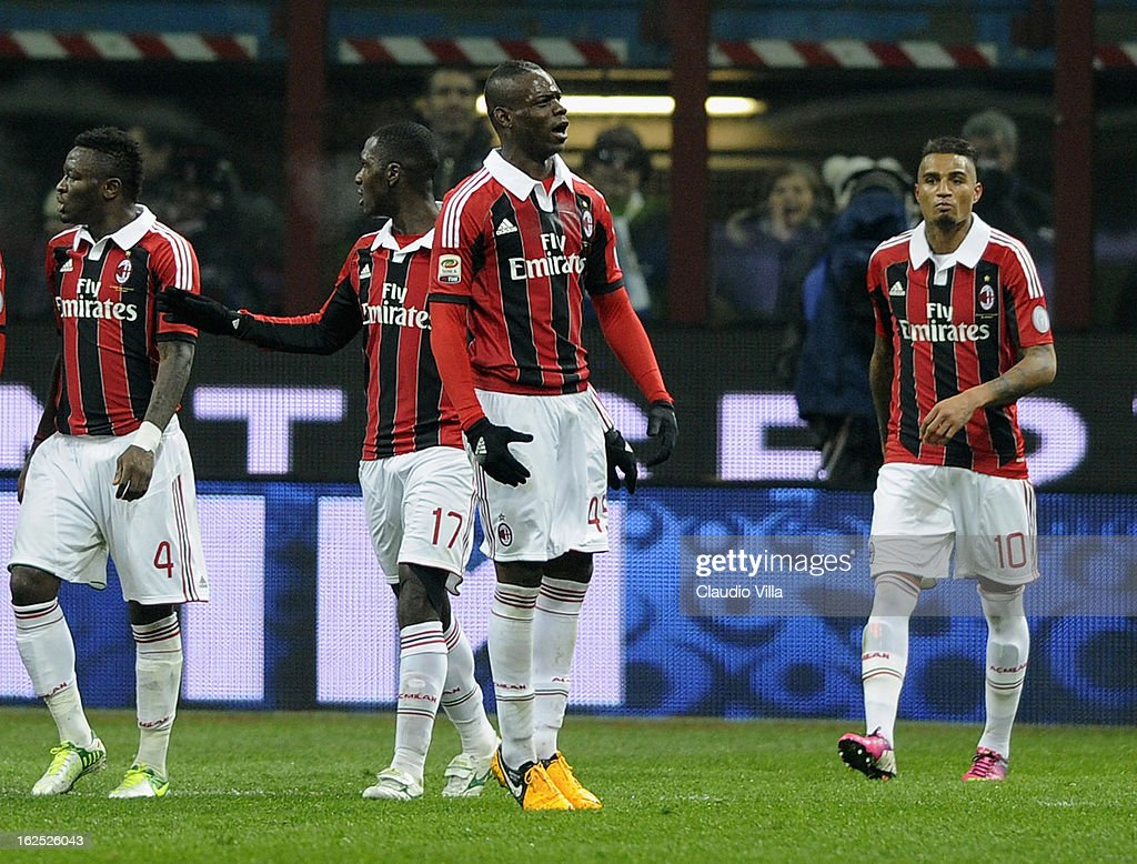 Mario Balotelli of AC Milan (C) celebrates during the Serie A match FC Internazionale Milano and AC Milan at San Siro Stadium on February 24, 2013 in Milan, Italy.