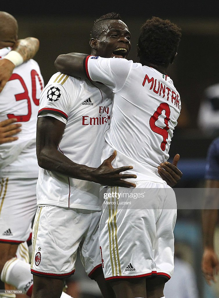 <a gi-track='captionPersonalityLinkClicked' href=/galleries/search?phrase=Mario+Balotelli&family=editorial&specificpeople=4940446 ng-click='$event.stopPropagation()'>Mario Balotelli</a> (L) of AC Milan celebrates his goal with team-mate <a gi-track='captionPersonalityLinkClicked' href=/galleries/search?phrase=Sulley+Ali+Muntari&family=editorial&specificpeople=533057 ng-click='$event.stopPropagation()'>Sulley Ali Muntari</a> (R) during the UEFA Champions League Play Off Second leg match between AC Milan and PSV Eindhoven at Stadio Giuseppe Meazza on August 28, 2013 in Milan, Italy.