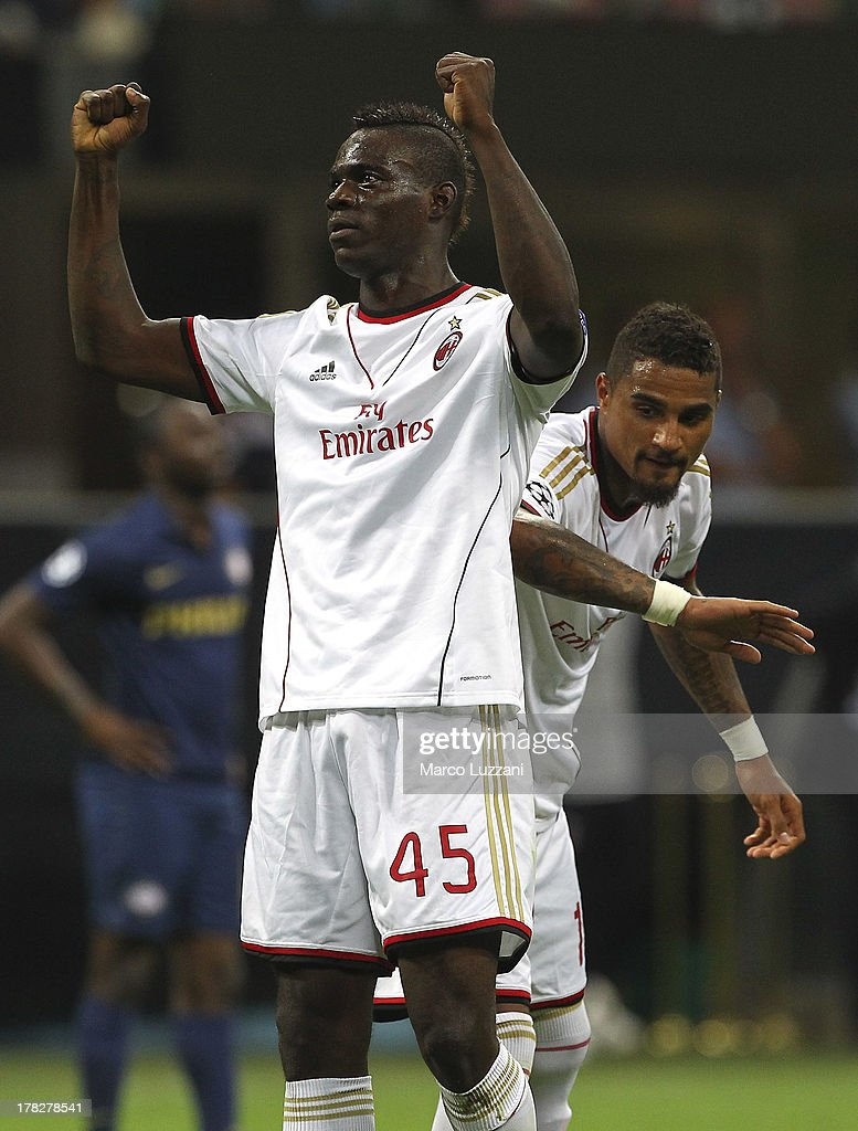 <a gi-track='captionPersonalityLinkClicked' href=/galleries/search?phrase=Mario+Balotelli&family=editorial&specificpeople=4940446 ng-click='$event.stopPropagation()'>Mario Balotelli</a> (L) of AC Milan celebrates his goal with team-mate <a gi-track='captionPersonalityLinkClicked' href=/galleries/search?phrase=Kevin-Prince+Boateng&family=editorial&specificpeople=613049 ng-click='$event.stopPropagation()'>Kevin-Prince Boateng</a> (R) during the UEFA Champions League Play Off Second leg match between AC Milan and PSV Eindhoven at Stadio Giuseppe Meazza on August 28, 2013 in Milan, Italy.