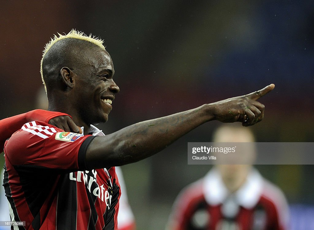 <a gi-track='captionPersonalityLinkClicked' href=/galleries/search?phrase=Mario+Balotelli&family=editorial&specificpeople=4940446 ng-click='$event.stopPropagation()'>Mario Balotelli</a> of AC Milan celebrates scoring his team's fourth goal from a penalty kick during the Serie A match between AC Milan and Calcio Catania at San Siro Stadium on April 28, 2013 in Milan, Italy.