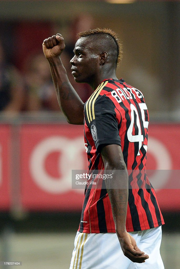 <a gi-track='captionPersonalityLinkClicked' href=/galleries/search?phrase=Mario+Balotelli&family=editorial&specificpeople=4940446 ng-click='$event.stopPropagation()'>Mario Balotelli</a> of AC Milan #45 celebrates scoring his team's third goal during the Serie A match between AC Milan and Cagliari Calcio at San Siro Stadium on September 1, 2013 in Milan, Italy.