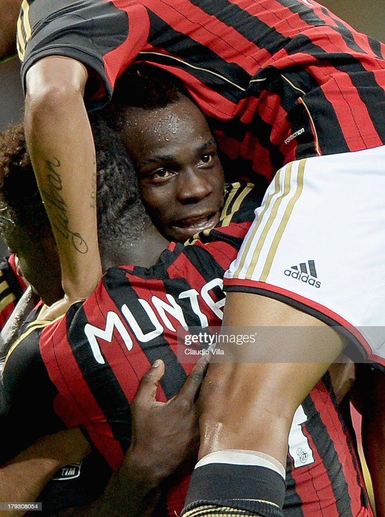 <a gi-track='captionPersonalityLinkClicked' href=/galleries/search?phrase=Mario+Balotelli&family=editorial&specificpeople=4940446 ng-click='$event.stopPropagation()'>Mario Balotelli</a> of AC Milan (C) celebrates scoring his team's third goal during the Serie A match between AC Milan and Cagliari Calcio at San Siro Stadium on September 1, 2013 in Milan, Italy.
