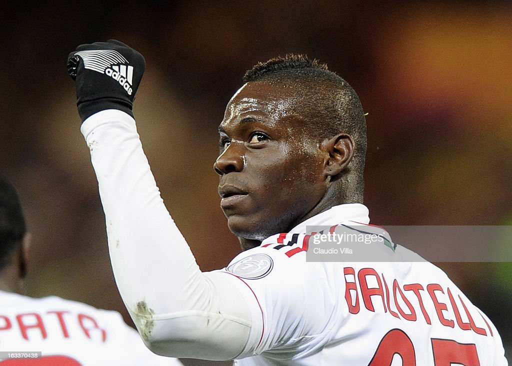 Mario Balotelli of AC Milan celebrates scoring the second goal during the Serie A match between Genoa CFC and AC Milan at Stadio Luigi Ferraris on March 8, 2013 in Genoa, Italy.