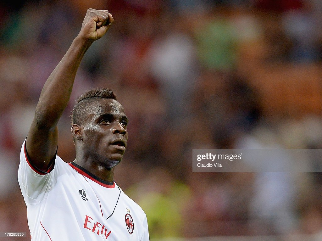 <a gi-track='captionPersonalityLinkClicked' href=/galleries/search?phrase=Mario+Balotelli&family=editorial&specificpeople=4940446 ng-click='$event.stopPropagation()'>Mario Balotelli</a> of AC Milan celebrates victory at the end the UEFA Champions League Play-off Second Leg match between AC Milan v PSV Eindhoven at Stadio Giuseppe Meazza on August 28, 2013 in Milan, Italy.