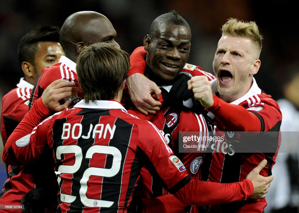 <a gi-track='captionPersonalityLinkClicked' href=/galleries/search?phrase=Mario+Balotelli&family=editorial&specificpeople=4940446 ng-click='$event.stopPropagation()'>Mario Balotelli</a> (C) of AC Milan celebrates with team-mates after scoring his second goal from the penalty spot during the Serie A match between AC Milan and Udinese Calcio at San Siro Stadium on February 3, 2013 in Milan, Italy.