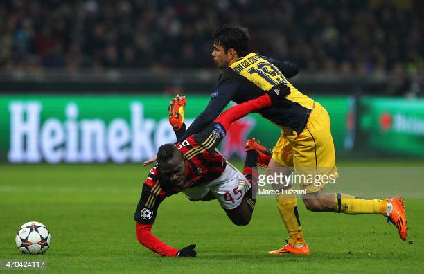 Mario Balotelli of AC Milan clashes with Diego Costa of Club Atletico de Madrid during the UEFA Champions League Round of 16 match between AC Milan...