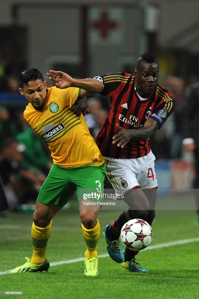 Mario Balotelli (R) of AC Milan competes with Emilio Izaguirre of Celtic during the UEFA Champions League group H match between AC Milan and Celtic at Stadio Giuseppe Meazza on September 18, 2013 in Milan, Italy.